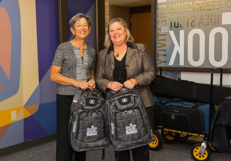 Carole Ratcliffe and Tina with backpacks at AACC Pitch Competition